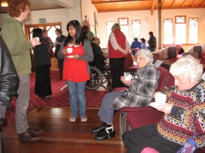 People having morning tea after a service
