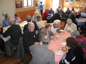 Groups sitting at tables for Friendship Lunch